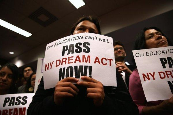 Demonstrators show support for the New York state DREAM Act at a rally in New York City.