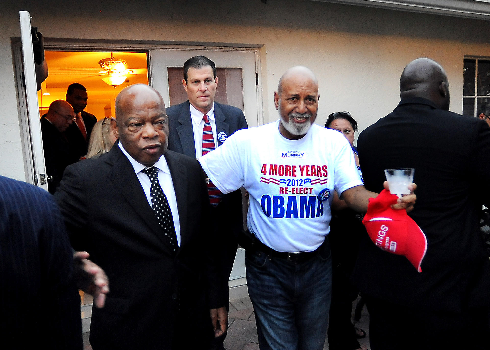 Congressman John Lewis, D-Ga., at left, appears at a Democratic Party event in Plantation accompanied by Broward Democratic Chairman Mitch Ceasar, center, and U.S. Rep. Alcee Hastings, at right.