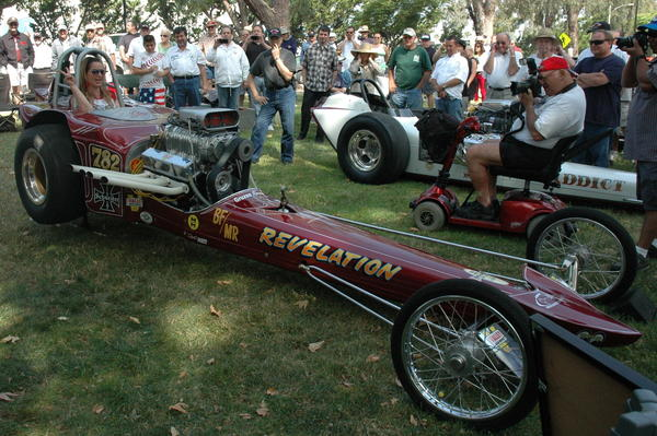 Anna Octane, with the Stormy Byrd Race Team, sits in the ruby red Revelation, a modified fuel roadster that roared during the Road Kings' Car Show last year at Johnny Carson Park.