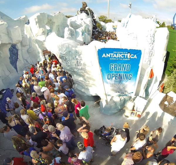 "Guests line-up at the entrance of the ""Antarctica: Empire of the Penguins"" attraction at SeaWorld Orlando on May 24, 2013."
