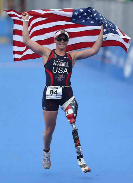 Chicagoan Melissa Stockwell celebrates her triumph in last year's Paratriathlon world championship in Auckland, New Zealand.