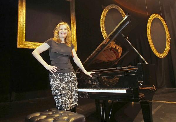 Mona Golabek stands at her Steinway and Sons piano, on stage at the Laguna Playhouse . Golabek is performing a one-woman show that centers around the piano.