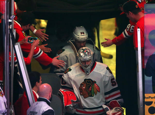 Corey Crawford and Bryan Bickell head out of the locker room Thursday for Game 4. (Scott Strazzante/Tribune photo)