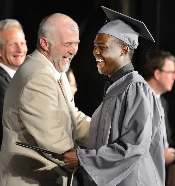 Washington County School Board member Wayne Ridenour and Matthew Murray share a laugh after Murray received his graduation diploma from Barbara Ingram School for the Arts Thursday evening.