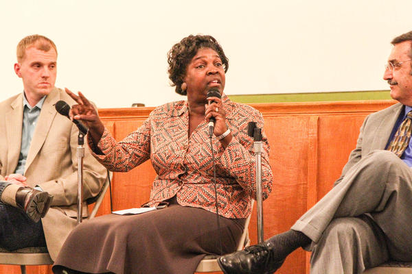 Left to right, panelists pastor Alan Brumback, pastor Valarie Houston, and interim Sanford Police Chief Richard Myers react during a forum about race hosted by The Orlando Sentinel and Fox35 News at the New Bethel Missionary Church in Sanford in October 2012.