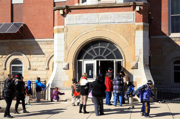 Students leave Von Humboldt Elementary School at the end of the school day in Chicago, Thursday, March 21, 2013.