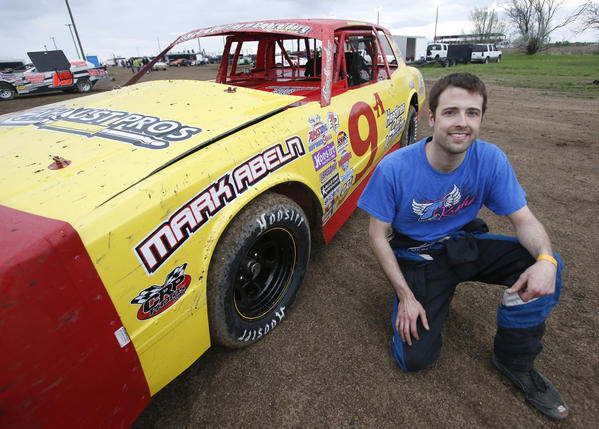 Brad Sheridan, of Groton, with his street stock car that is a replica of the car his father Sheldon Sheridan drove. photo by john davis taken 5/31/2013