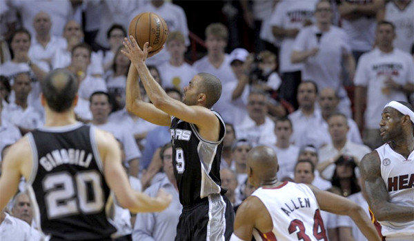 Tony Parker takes a shot late in the fourth quarter in front of teammate Manu Ginobili and Miami's Ray Allen and LeBron James during the Spurs' 92-88 victory over the Heat in Game 1 of the NBA Finals.
