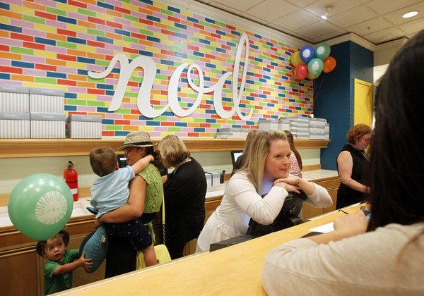 The checkout area of Land of Nod, the sister store of Crate & Barrel devoted to children's decor. The wall in back, which looks like candy-colored subway tile, was painted by the store's creative director.