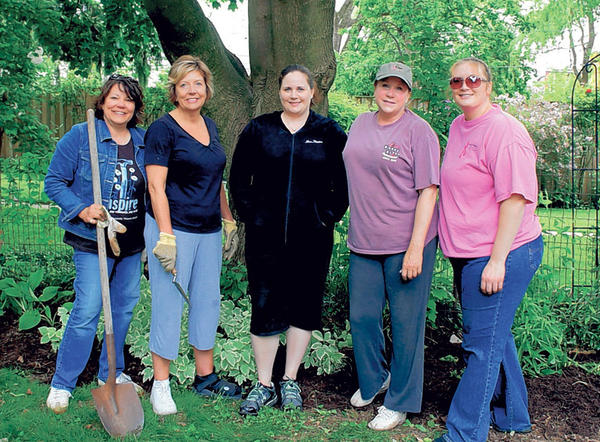 From left, Pam Cole, Crista Shoemaker, Leigh Hunter, Linda Shirey and Amanda Frew participated in the Soroptimist International of Hagerstown gardening day at the Holly Place senior assisted living facility. Not shown is Pam Steiner.