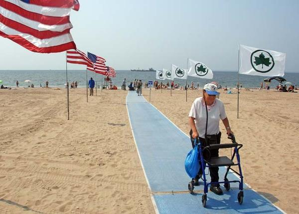 MobiMats are designed to allow easier access across sand for individuals in wheelchairs and families with strollers.