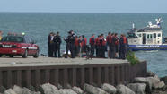 The identities of two men whose bodies were pulled from Lake Michigan Thursday afternoon on the North Side have been have been released, authorities said.
