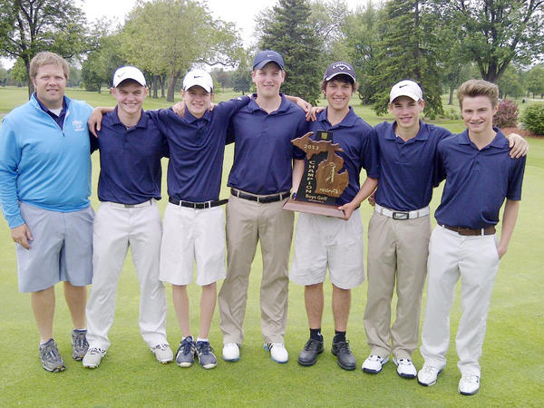 The Petoskey High School varsity boys golf team captured their first regional title since 1994 Thursday as they won the Division II regional at Spring Meadows Golf Club in Linden. The Northmen advance to the Division II state finals June 14-15 at The Meadows at Grand Valley State University. Team members are (from left) coach Chad Loe, Silas Lee, Adam McCain, Cam Ludlow, Tyler Speigl, Colin Green and Jesse Peters.
