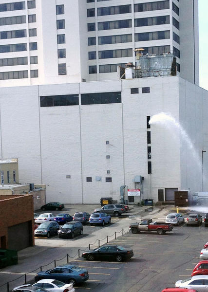 South Bend Tribune/ELISABETH CLARK Some people in downtown South Bend on Friday morning might have noticed this stream of water gushing out of the northwest corner of the Chase Tower parking garage. The buildings manager, Bruce Gordon, said it was part of planned, preventive maintenance to test the 25-story buildings fire-suppression system. Crews did the same thing to the tower in May 2012.