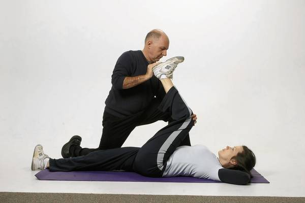 Steven Weininger, an Atlanta-area chiropractor and posture expert, demonstrates one of his StrongPosture exercises on a patient.