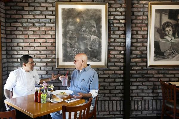 Phil Gittelman, right, has long rooted for Hugo's chef Nabor Diaz, who started there as a dishwasher 25 years ago.