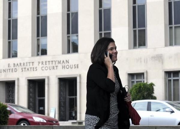 A woman talks on the phone in front of the U.S. Courthouse in Washington on Thursday where the secret Foreign Intelligence Surveillance Court resides. The court granted an order by the National Security Agency for Verizon to secretly turn over the telephone records of millions of U.S. customers.