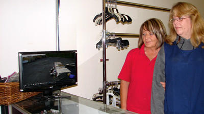 Libby Albright, manager of the Salvation Army Family Store, and cashier Cindy Maust watching a recording of someone stealing from the donation bins.