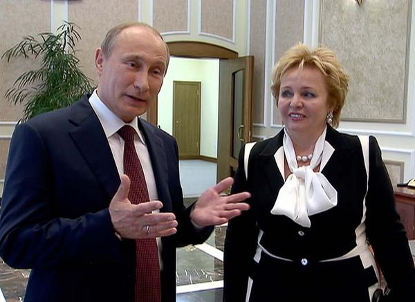 "Russian President Vladimir Putin and his wife, Lyudmila, speak to journalists after attending the ballet ""La Esmeralda"" in the Kremlin Palace in Moscow. They said Thursday they are divorcing after nearly 30 years of marriage, making the announcement on state television after attending a ballet performance at the Kremlin."