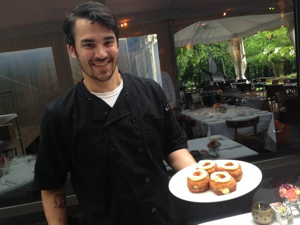 Gertrude's executive pastry chef Doug Wetzel holds a plate of Croi-nuts. A different version of the pastry has been added to Gertrude's menu.