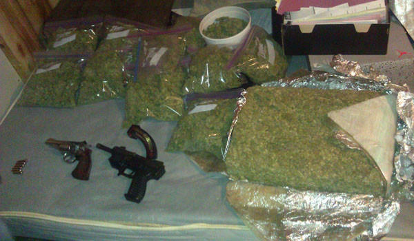 Some of the 44 pounds of what police believe is marijuana, as well as two guns, found when Cook County Sheriff's deputies served an eviction notice at a Gage Park home.