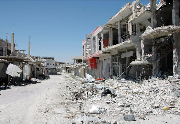Heavy damage was left behind after Syrian government troops, with help from Hezbollah fighters, took control of the city of Qusair from rebels.