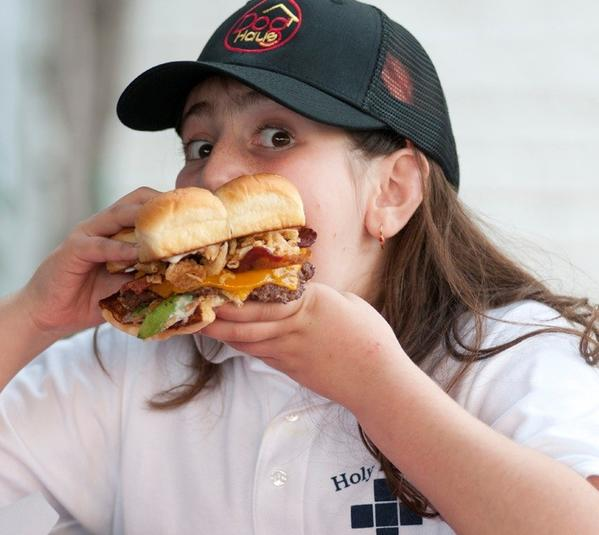 Gabriella Pontrelli bites into a Gabby Burger.