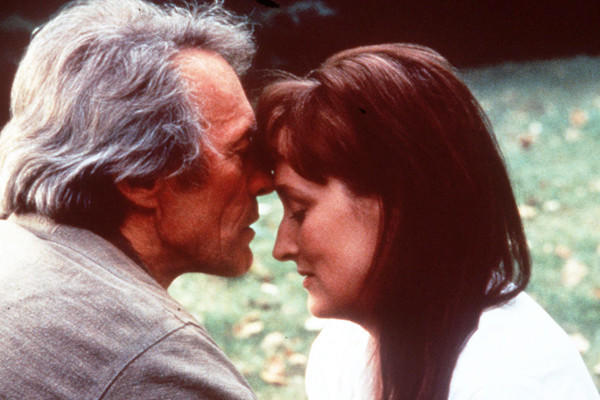"This undated film image released by Warner Bros. shows Clint Eastwood, left, and actress Meryl Streep in a scene from. ""The Bridges of Madison County."" The book made into a film starring Meryl Streep and Clint Eastwood, is heading to Broadway as a musical. Producers said Thursday, June 6, 2013, the show, with songs by Jason Robert Brown and a book by Marsha Norman which debuts at the Williamstown Theatre Festival in Massachusetts this August, will land at the Gerald Schoenfeld Theater in January. (AP Photo/Warner Bros., file) ** Usable by LA and DC Only **"