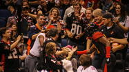 Orlando Predators wide receiver T.T. Toliver, right, hands a young fan the football after scoring a touchdown during a loss to the Tampa Bay Storm in April. (Joshua C. Cruey, Orlando Sentinel)