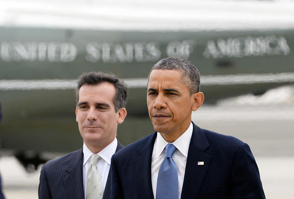 President Obama walks with Los Angeles Mayor-elect Eric Garcetti upon his arrival at Santa Monica Airport.