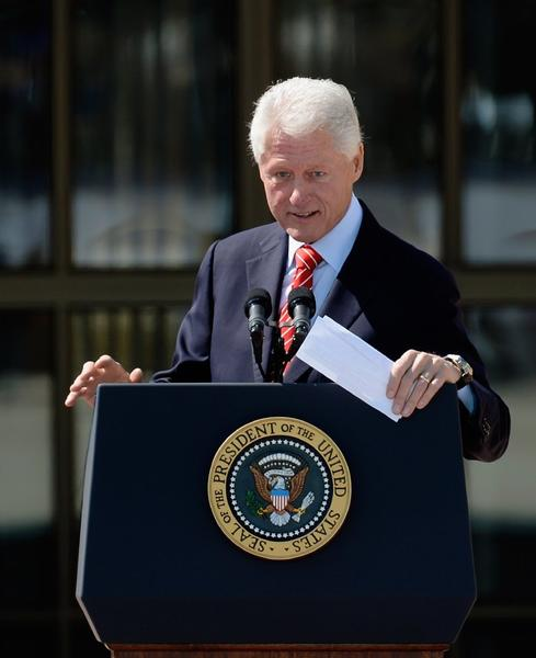 Former President Clinton said Friday that California's implementation of the Affordable Care Act could serve as a model for other states. Above, he speaks in April at George W. Bush's presidential library.