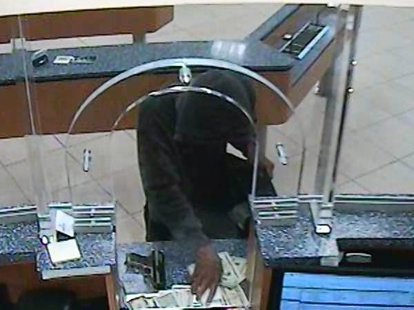 Image of a man robbing Fairwinds Credit Union in Four Corners.