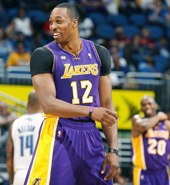 Los Angeles center Dwight Howard smiles late in the game during the Los Angeles Lakers at Orlando Magic NBA game at the Amway Center in Orlando on Tuesday, March 12, 2013.