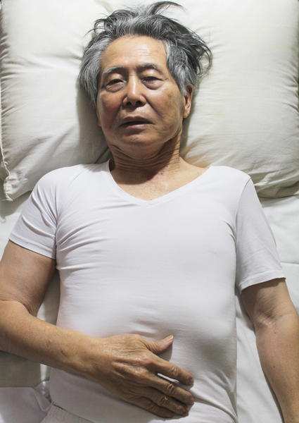 Former Peruvian President Alberto Fujimori is shown lying in bed in prison.