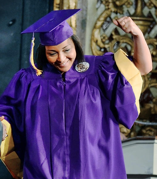 Joyce Edwards pumps her fist after her name was called to recieve her diploma during Smithsburg High School graduation excercises at The Maryland Theatre Friday.