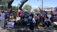 RANCHO MIRAGE – Protesters gathered Friday afternoon near the Sunnylands estate, hours before President Obama and Chinese leader Xi Jinping are expected to arrive for an informal summit.