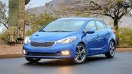 After driving the 2014 Kia Forte, I exited the car with one overriding thought: Honda should watch its back. For the fifth model year of its popular compact sedan, the Korean automaker is seriously upping its game, offering luxury-level amenities at what is likely to be a bargain-basement price.