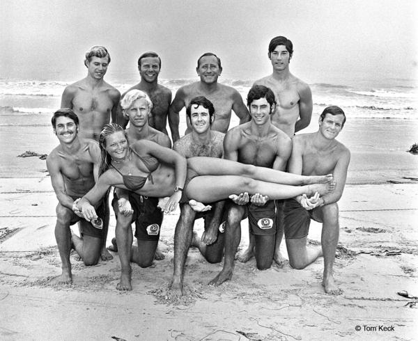 Del Mar city lifeguards pose for their yearly photo in 1971. Kneeling left to right are Tom Cozens, Robert Maurer, Robert Smith, Vernon Rye III and Brad Smith. Standing left to right are Dan Jago, Petey Hoff, Gardner Stevens and Dave Grossman. Joyce Hoffman, the fe