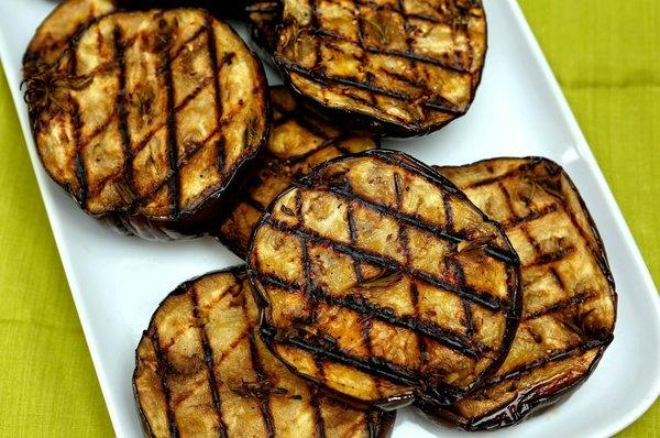 Grilled eggplant with anchovies, garlic and rosemary.
