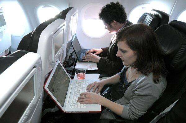 Virgin America passengers use onboard wireless Internet on a flight in 2009.