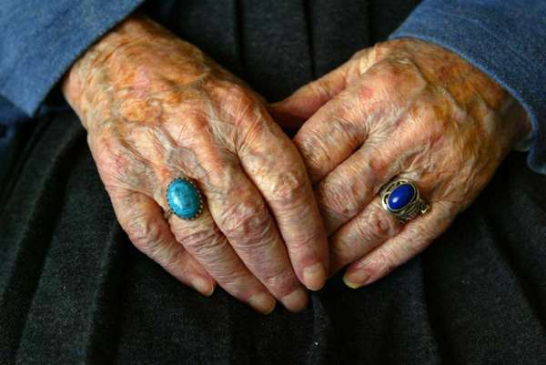 The hands of Marion Higgins of Seal Beach, who was the oldest person in California when she died in 2006, at 112. Researchers in the journal Cell published a list of the nine hallmarks of aging on the cellular level.