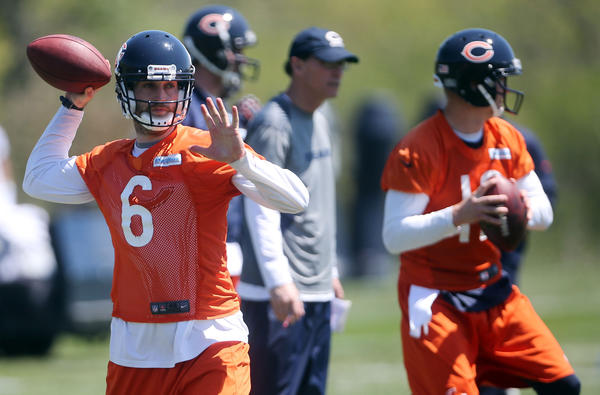 Quarterback Jay Cutler, left, during Bears OTAs on Tuesday. (Brian Cassella/Tribune photo)