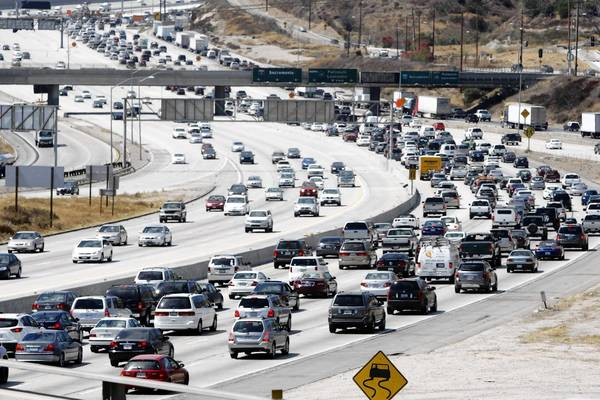 Heavy traffic slows the northbound lanes of the 5 Freeway at the 14 Freeway before the long Labor Day weekend last year. More Americans plan to take trips by car this summer than last, a TripAdvisor survey said.