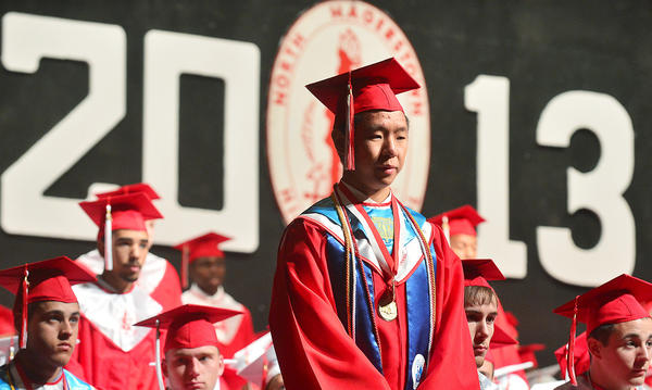 Noah Mun stands Friday during commencement ceremonies at North Hagerstown High School. Mun was being recognized with fellow seniors who have plans to join the military.
