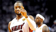 MIAMI — Dwyane Wade was back, ripping through the San Antonio defense as if he never felt the effects of his troublesome right knee.