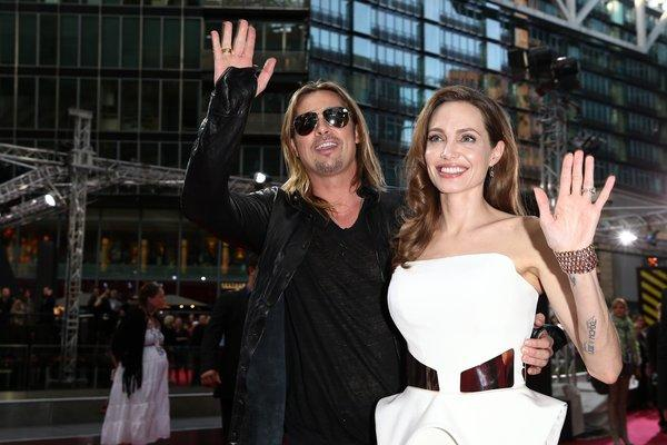 "A cheery Jolie showed up in the arms of husband Brad Pitt at the premiere for his newest movie, ""World War Z,"" on Monday. This marks the actress' first venture into the public eye after three months of procedures to remove both breasts. Jolie disclosed her decision and revealed a family history of breast cancer in a New York Times op-ed."