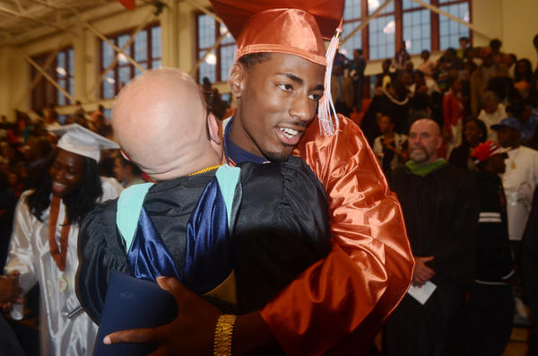 Capital Prep Magnet School student Antwan Byrd hugs his teacher Scott Wojnarowicz Friday evening after the commencement ceremony.