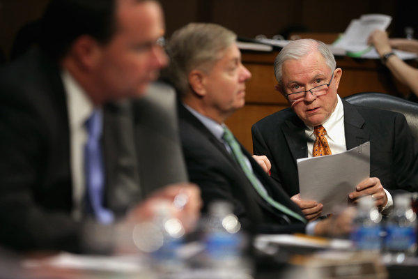 Senate Judiciary Committee member Sen. Jeff Sessions (R-Ala.), right, listens to debate during a markup session for the immigration reform legislation in the Hart Senate Office Building on Capitol Hill.