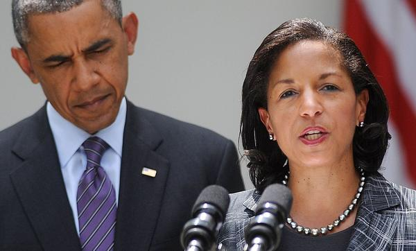 Newly appointed national security adviser Susan Rice speaks as President Obama looks on during a event in the Rose Garden at the White House in Washington, D.C.