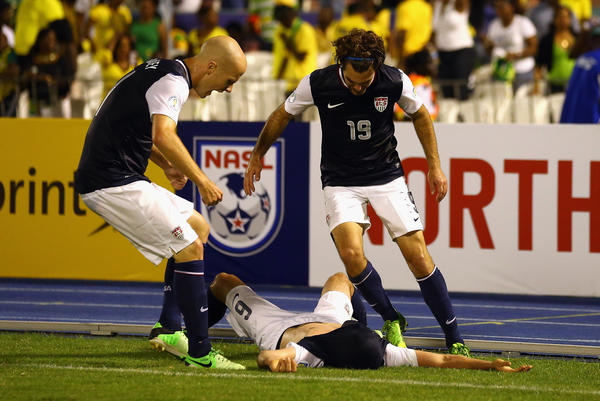 Michael Bradley, left, and Graham Zusi, right celebrate with Brad Evans after Evans scored the winning goal to beat Jamaica 2-1 during the FIFA 2014 World Cup Qualifier.(Photo by Streeter Lecka/Getty Images)